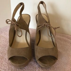 Nine west size 9 1/2 tan colored open toe wedge